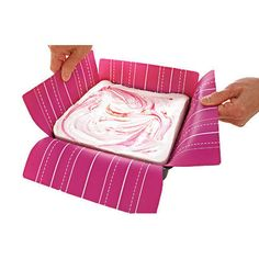 Less sticking - less hassle. Use a silicone baking mat and easily lift out marshmallows, fudge, brownies, cakes, crispy treats and other desserts. The mat is designed to fit 8 x 8 or 9 x 9 pans. Center the silicone mat in the bottom of the pan, the mat will extend up the side walls and over the edge of the pan. Use this excess silicone to easily lift the prepared candy or dessert out. The printed gridlines allow for cutting 3 different sized pieces - use thick lines for 16 large, thin lines…