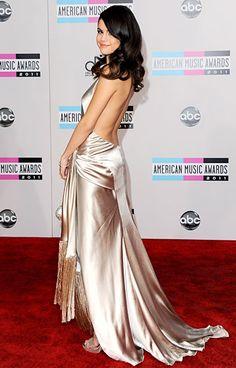 Selena Gomez in a very sexy silver dress by Giorgio Armani.