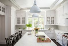 A kitchen doorway is fitted with glass display cabinets. A kitchen doorway is…