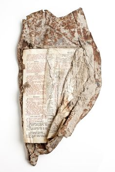 An open bible fused into metal was found by a NY firefighter during the recovery phase at Ground Zero post-9/11.