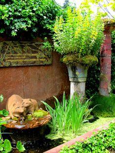 "Racoon fountain in the ""old"" Little & Lewis garden, Bainbridge Island, WA"
