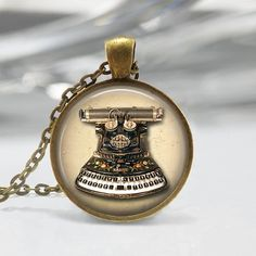 This high quality image is enhanced with a glass dome to add depth and set in a 1 finished pendant bezel in your choice of antique bronze or Book Jewelry, Music Jewelry, Camera Necklace, Typewriter Keys, Keys Art, Pocket Watch Antique, Thing 1, Mermaid Necklace, Vintage Typewriters