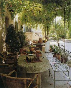 vine-covered pergola--Notre maison de famille | Hugues & Jean Bosc - Blog