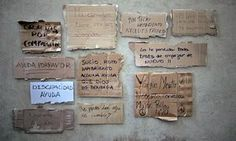 A selection of cardboard signs made by Barcelona's rough sleepers, which inspired five new fonts