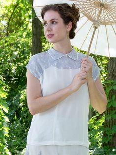 A hopeless romantic's dream, the Dove blouse is dainty and delicate, and an absolutely unique treasure. Smoke blue lace on the shoulder, upper bodice and collar are artfully applied to the moss crepe body. This style works fabulously with the Dove skirt.