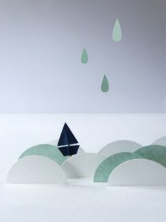 paper boat waves and rain motif - would look really cool in fondant on top of a birthday cake!!