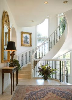 Beautiful staircase and foyer/landing decor! Well balanced.