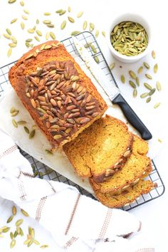 Extremely moist gluten-free pumpkin bread that's fragrant, tasty and topped with pumpkin seeds that are toasted for a crunchy bite.