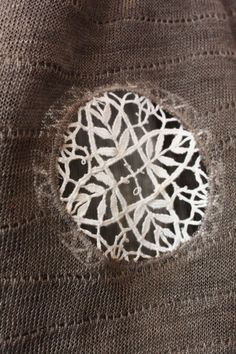 using a piece of lace to mend