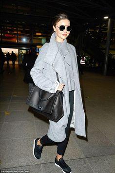 Miranda Kerr wearing Givenchy Shark Bag and Amanda Wakeley Ito Grey Wool and Shearling Coat