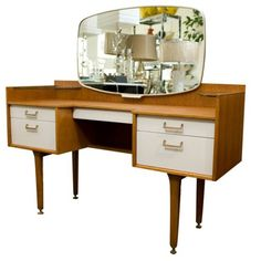 Image from http://www.galahome.com/wp-content/uploads/2014/12/Cool-design-for-stylish-dressing-table-with-brown-table-design-with-glass-shelf-on-side-table-with-white-drawer-with-colorful-dressing-tables.jpg.