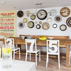 I love these kitchen chairs! The clocks are un too, set for different times in different countries, I assume? Love the vintage Beatles Poster!