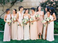 We love bridesmaids shots like this! Mis-matched bridesmaids dresses in ivory, blush, and gold