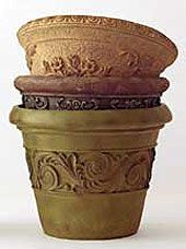 """Wood stain is a great way to give an """"antiqued"""" look to a new terra cotta pot fast. You can use either gel wood stain or liquid wood stain. A darker color like a """"walnut"""" usually works really well. Instructions here: http://www.weekendgardener.net/container-gardening/antique-claypots-110711.htm"""