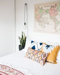 Doesn't everyone want a map above their bed to dream?  photo via Sophie Timothy for @apartmenttherapy // via instagram @curatedinterior