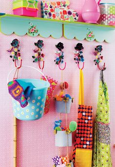 Not strictly a studio but I love the colours & the hooks/shelves