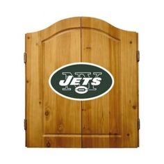 This NFL New York Jets Wooden Dartboard Cabinet Set is made of solid  pine and makes a great gift for the sports fan in your life. This  officially licensed dartboard comes with mounting hardware and six team  logo darts.   Great gift for sports fan Perfect for man cave or garage Made by Imperial International Solid pine wood dartboard cabinet All natural 18-inch bristle dart board Mounting instructions and hardware included Six steel darts with team logo on flights Includes chalk and eraser…