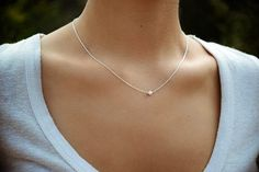 Delicate, minimalist necklace with elegant sterling silver chain and centered sterling silver stardust bead