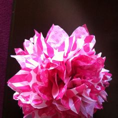 Tissue paper flower. Will try this next time I give a gift. Might be really pretty as a box topper.