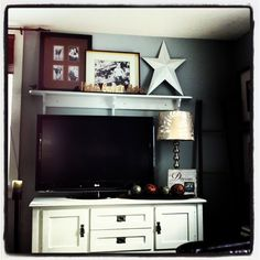 Decorating around a flat screen ...interesting idea for repurposed mantle