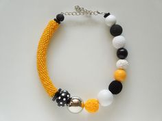 Yellow Black and White asymmetric necklace with crocheted seed beads and other big handmade beads. #ivadidit