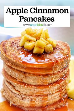 These Fluffy Apple Cinnamon Pancakes are fast, easy, and oh SO delicious! Perfect weekend breakfast or brunch. Get the full printable recipe at UrbanBlissLife.com #pancakes #breakfast #brunch #apples #fallfood #maplesyrup #recipes #easyrecipes #fallrecipes #applerecipes