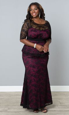 Delicate black lace, flattering peplum and a magenta pink lining screams femininity. Glam up your life with our plus size Astoria Lace Peplum Gown. www.kiyonna.com  #Kiyonna #pinkdress #blacklace #cocktaildress