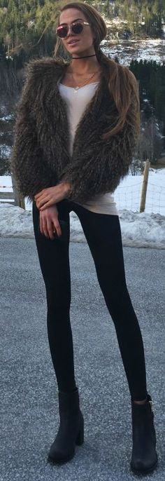 Faux fur vest, white tee, black leggings, black booties | Kristine Ullebo