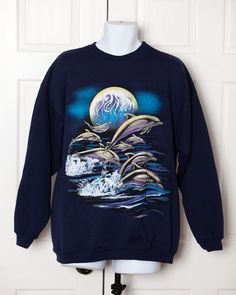A personal favorite from my Etsy shop https://www.etsy.com/listing/478675946/vintage-90s-dolphin-sweatshirt-xl