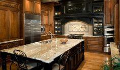 typhoon bordeaux granite countertops wood cabinets kitchen design ideas