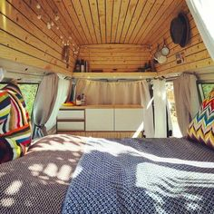I love the wood ceiling on this camper van. Now I really want to build a van! There's so much cool interior inspiration in this blog article. #vanlife goals. #campervanideas