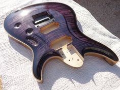Sabre Guitars  Ultraviolet Burst full gloss Lacquer finished on Aaron Clark's Wraith FR-6 Maple and black limba body.
