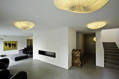 Coral ceiling lamps in a private home. The minimal space is warmly lit by these beautiful fixtures.