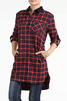 This stylish plaid button up shirt is perfect for winter! Cozy and warm, it pairs great with skinny jeans or leggings and boots! True to Size.