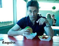 It's Jon Hamm. Eating a Hamm-burger.  Heh. Heh.