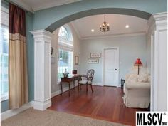 columns. great idea for the door that leads from the dining