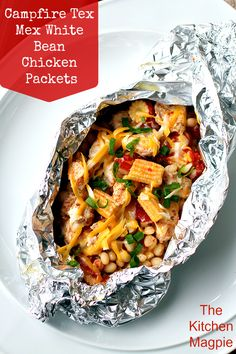 ~ Campfire Tex Mex White Bean Chicken Foil Packets  ~  These are seriously the yummiest camping foil packet dinner's I've made so far! Healthy and amazing Tex Mex White Bean  Chicken foil packets. Cook them on the BBQ, the campfire or at home in your oven, any way you do them, they are seriously delicious!  | From the Kitchen Magpie