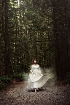 Obsessed with the movement and colors. Love the white dress in the thick woods.