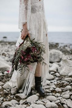 Bohemian goddess wedding dress + black combat boots + edgy bridal bouquet | Image by Wianda Bongen Photography