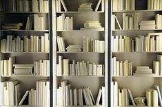 20 Bookshelf Decorating Ideas - Decoist - via http://bit.ly/epinner (Cover the books you can't let go, to match your decor).  I would prefer a little color...
