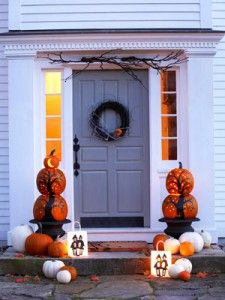 Halloween Outdoor Decor - I like the tower of pumpkins painted like black trees and cut out like starry night. Cute idea for black branches too.