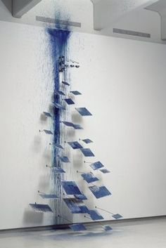 """Artist: Rebecca Horn """"The Little Painting Performs a Waterfall"""" (1988) metal rods, aluminum, sable brushes, electric motor, acrylic on canvas Collection: Walker Art Center"""