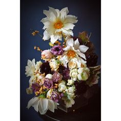 Pale yellow and purple fall bouquet featuring dahlias and begonia foliage. Designed by Sullivan Owen