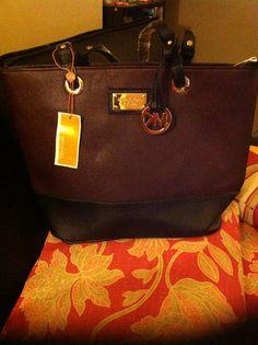Michael Kors purse. New $60 Colour is Burgundy/dark navy blue