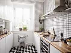 A serene home in neutrals and dusty hues / My Scandinavian Home / Love this cute, bright kitchen! The butcher block counter top is gorgeous, and love the checkered flooring!