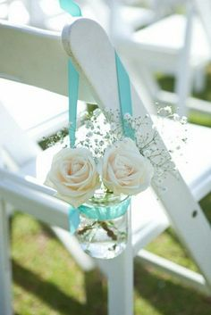 roses in mason jars with aqua ribbon wedding chair decoration ideas for beach weddings / http://www.himisspuff.com/ribbon-wedding-ideas/3/