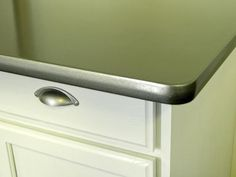 Can't afford a kitchen makeover? Paint it! Thomas' Liquid Stainless Steel can be used on appliances, faucets and countertops. The water-based resin is stainless steel in liquid form, and it provides a brushed-stainless look that is as durable as an automotive-grade finish. 8 Things You Didn't Know You Could Paint : DIY Network or I have always wanted concrete accent walls and countertops