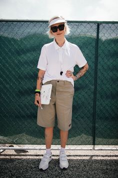 "Acne's Louise Du Toit perfects ""camp-counselor chic."" We can't decide what we love most: her khaki Bermuda shorts, her whistle necklace, or her so-sporty white visor. #refinery29 http://www.refinery29.com/adidas-fanatic-new-york-athleisure-street-style#slide-14"