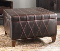 Decorative Top Stitched Storage Ottoman Western Ottomans - Rugged sable brown faux leather with decorative stitching, nail head detail, removable top and wooden legs finished in weathered hickory.