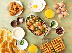 Chicken and waffles meets nachos with this hearty breakfast or brunch dish. Homemade cheddar waffles topped with a basic cheese sauce, popcorn chicken, bacon, scallions, jalapeno and a fried egg.